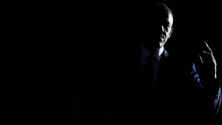 Obama departs the stage after concluding his farewell address in Chicago